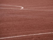Mineral sports surface materials